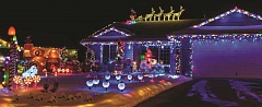LON AUSTIN/CENTRAL OREGONIAN - Santa and his reindeer are on the roof of this Prineville home.