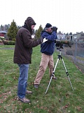 PHOTO BY ELLEN SPITALERI - Dan Strong, right, uses his binoculars to track birds on a lake near a mobile home community in Milwaukie, while Ron Myers enters the count on his tally sheet.