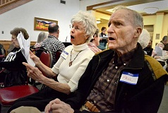 SPOKESMAN PHOTO: VERN UYETAKE - Share singer Nancy Rowinski of West Linn joins SpringRidge resident Paul Robinson in a singalong at the Wilsonville facility in January. Share Singers work to engage seniors through music.