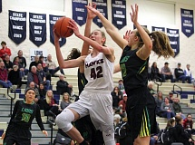 PMG PHOTO: MILES VANCE - Southridge's Cameron Brink gets fouled as she goes to the basket during her team's 53-32 win over West Linn in the first round of the Nike Interstate Shootout at Lake Oswego High School on Tuesday.
