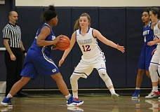REVIEW/NEWS PHOTO: JIM BESEDA - La Salle's Reese Timm (12) keeps a close eye on Grant's Alexis Richmond during Tuesday's opening round of the Nike Interstate Shootout at Lake Oswego High School.
