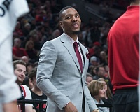 TRIBUNE PHOTO: JOSH KULLA - Damian Lillard of the Trail Blazers is all dressed up but with no place to play, but even with him on the bench, Portland was able to defeat the Sacramento Kings on Wednesday night at Moda Center.