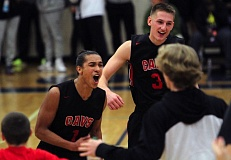 Clackamas' Elijah Gonzales (left) and Hunter Coyle celebrate after defeating four-time defending Oregon state champion West Linn 88-87 in the Les Schwab Innvitational at Liberty High School on Thursday. TIDINGS PHOTOS: MILES VANCE