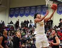 TIDINGS PHOTO: MILES VANCE - West Linn's Keishon Dawkins scores during his team's 87-86 loss to Clackamas in the Les Schwab Invitational at Liberty High School on Thursday.