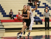 REVIEW/NEWS PHOTO: JIM BESEDA - Oregon City's Kylie Guelsdorf drives for two of her game-high 18 points in Friday's 57-43 vicotry over Clackamas during Friday's Nike Interstate Shootout at Lake Oswego High School.