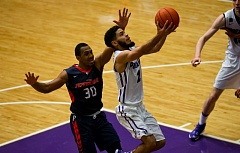 COURTESY: STEVE GIBBONS/UNIVERSITY OF PORTLAND - Alec Wintering drives for two of his 23 points