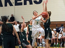 TIDINGS PHOTO: MILES VANCE - West Linn's Lexie Pritchard grimaces as she goes up for a shot during her team's 60-51 win over Jesuit in the Nike Interstate Shootout at Lake Oswego High School on Friday.