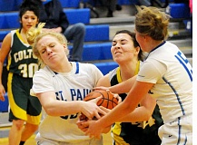 SETH GORDON - Isabelle Wyss (left) and Megan Tuck tie up Colton center Becca Burge during St. Paul's 40-35 home victory Dec. 28. The Bucks are 7-2 entering Tri-River Conference play this week.