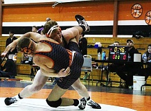 PHOTO CREDIT: JENI SUE - Indians junior Nate Maller pins Yamhill-Carlton/Gaston senior Kevin Howel in 1:28 at the Mollala Duals on Friday, Dec. 30, 2016.
