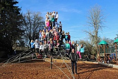 REVIEW PHOTO: JILLIAN DALEY - Members of the Hallinan Elementary School Green Team hang out at the hexamid play structure during recess, while Rick Griest, Green Team coordinator, stands by.
