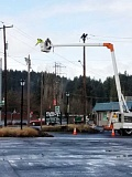 CONTRIBUTED PHOTO: MELANIE WAGNER - Workers from Portland General Electric work to remove utility poles near the intersection of Highway 224 and Broadway Street. The poles will be replaced with underground conductors in order to provide more reliable service.
