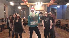 COURTESY PHOTO - Jeff Farrar, manager at Ridgewalker taproom in Forest Grove, plays the Sassy Santa in a video advertising an ugly sweater dance party at the venue. Farrar and his co-workers have a good time coming up with new, entertaining material for the taprooms Facebook page.