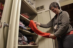 SPOTLIGHT FILE PHOTO - Jan Stites, lead volunteer at the Columbia County Warming Center, folds donated items before putting them into a storage closet. The center is open every Friday and nights when the temperature drops below freezing.