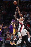 TRIBUNE PHOTO: JAIME VALDEZ - Evan Turner (right) of the Trail Blazers shoots over Louis Williams of the Los Angeles Lakers.