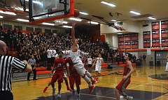 TIMES PHOTO: MATT SINGLEDECKER - Beaverton senior point guard Cole Johanson finishes at the rim with the go-ahead hoop against Westview on Friday.