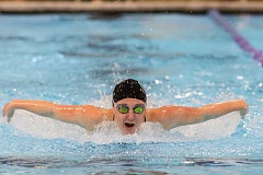HILLSBORO TRIBUNE PHOTO: CHASE ALLGOOD - Centurys Riley Neal swims to a first place finish in the 100-meter butterfly.