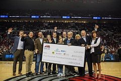 PORTLAND TRASIL BLAZERS - The Portland Metro New Car Dealers Association presented a check from its 2016 Sneak Peek Charity Party at a Portland Trail Blazer game. From left, those pictured and their organizations are: Russ Humberston Jr., Beaverton Toyota; Tony Staser, Meals on Wheels; Todd Coffman, EC Company/Meals on Wheels board member; Jim Fisher, Fisher Volvo; Maddie Remensperger, PMNCDA; Doug Cain, Providence Medical Center; MacKenzie Beasley, Lanphere Enterprises; Shannon Inukai Cuffee, Dick's Auto Group (in the back behind MacKenzie); Greg Remensperger, PMNCDA; Bob Lanphere Jr., Lanphere Enterprises; Chris Meier, Herzog Meier Auto Center (behind Bob Lanphere); Judy Summers, JDRF; Dave Jachter, Wilsonville Toyota/ Wilsonville Subaru; and Erin Hubert, Boys and Girls Club Portland.
