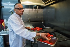 OUTLOOK PHOTO: JOSH KULLA - Maharaja co-owner Narinder Singh prepares a chicken kebab for barbecuing in the kitchen of the Maharaja, a new Indian restaurant at the corner of Northeast Hogan Road and 242nd Avenue.