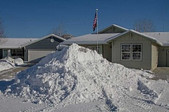 PHOTO COURTESY OF MICHAEL REDHEAD - A local resident is more than happy to give away the snow that has piled up near their home.