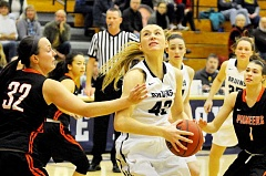 SETH GORDON - Kaitlin Jamieson eyes the bucket during George Fox's 79-61 home win over Lewis & Clark Jan. 3. Jamieson scored 11 points and blocked four shots.