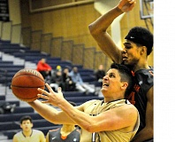 SETH GORDON - Senior guard Brendan Jones attempts to sneak under a Lewis & Clark defender during George Fox's 103-96 overtime victory Jan. 3. Jones scored seven points.