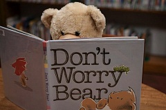 CONTRIBUTED PHOTO - A teddy bear at last year's sleepover, taking some down time away from his person to digest a good book.