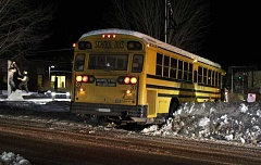 HOLLY M. GILL - A 509-J school bus got stuck in the snow early Tuesday morning as it turned onto E Street, in front of the Madras City Hall. It was the second bus incident involving weather conditions in less than a week.