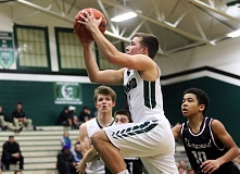 DAN BROOD - Tigard senior guard Luke Smith goes up to the basket during the Tigers' win over Sherwood.