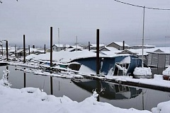 SCAPPOOSE FIRE DISTRICT PHOTO - The roof on a marina at Happy Rock Moorage collapsed early Wednesday, after bearing the weight of a large accumulation of snow. The structure caught fire when the roof fell on several propane heaters in use.
