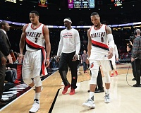 TRIBUNE PHOTO: JOSH KULLA - Trail Blazers guards CJ McCollum (left) and Damian Lillard (right), along with forward Noah Vonleh, walk off the court after losing to Orlando.