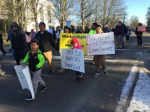 PARIS ACHEN - Demonstrators march around the Oregon Capitol Saturday, Jan. 14, 2017, in opposition to President-elect Donald Trump's positions on immigration.