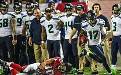 TRIBUNE PHOTO: MICHAEL WORKMAN - Devin Hester (right) showed some sparkle in the return game for the Seattle Seahawks, but the team couldn't keep pace with the Atlanta Falcons in Saturday's NFC divisional playoff game at the Georgia Dome.