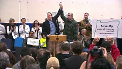 PHOTO COURTESY OF KOIN TELEVISION - Five of Oregon's congressional delegation attended a rally in Portland on Wednesday to support the Affordable Care Act. Lawmakers include, from left, Sen. Ron Wyden, Sen. Jeff Merkley and Rep. Kurt Schrader, seated.