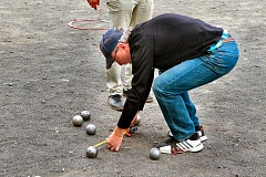 DAVID F. ASHTON - Seeing players using measuring tapes was a common sight at the Rose City Open pétanque tournament, held in late September at Westmoreland Park.