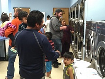 (Image is Clickable Link) CONTRIBUTED  - Local families work together to get their clothes clean for the month at a Jan. 10 laundry night.