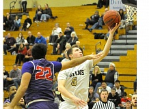 GARY ALLEN - Ryan Thistlewood glides to the hoop for an easy finish Saturday during George Fox's 75-73 home loss to Linfield. Thistlewood scored six points.