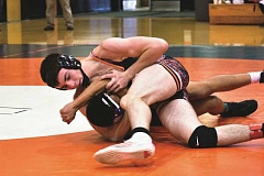 PHOTO COURTESY OF BRIAN MOUNT  - 145-pounder Ryan Mount pins Woodburn's Gerardo Gutierrez of Woodburn in 2:31 during the quarterfinal round at the Snowmageddon Challenge at Molalla High School Jan. 14.