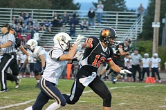 PIONEER PHOTO: CONNER WILLIAMS - Aaron Alexander races past a Banks defender during the Indians' exciting shootout versus the No. 1-ranked Braves in week three this season. Molalla won the game 34-28.