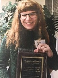 CONTRIBUTED PHOTO: KATE RAYMER - Kate Raymer smiles as she holds an award she won during the Estacada Chamber of Commerces Community Recognition event for her work with local seniors.
