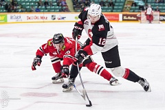 COURTESY: BRETT CULLEN - Jansen Harkens (right) of the Prince George Cougars, who scored in the first period, gets around Portland Winterhawks defenseman Henri Jokiharju during a Western Hockey League game Wednesday night at Prince George.