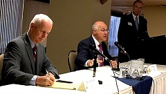 FILE PHOTO - Democrat Brad Avakian, center, speaks while Republican Dennis Richardson listens at a business-sponsored forum on Sept. 29, 2016.