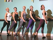 PHOTOGRAPHY BY JAIME VALDEZ - Xtend Barre instructor Margaret Winterhouse, right, poses with her class at the studio at Progress Ridge TownSquare.