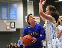 PMG PHOTO: MILES VANCE - Newberg's Taylor Rarick looks for room to operate during her team's 67-39 win at Lakeridge High School on Friday.