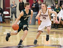 REVIEW/NEWS PHOTO: JIM BESEDA - Putnam's Jacob Halladin sets the Kingsmen's offense in motion while Milwaukie's Sam Bergener brings defensive pressure during the first half of Friday's Northwest Oregon Conference game.