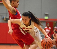 OUTLOOK PHOTO: DAVID BALL - David Douglas guard Jie Tan attempts to gain the baseline against Centennials Gianna Loville during the Scots 58-47 home win Thursday.