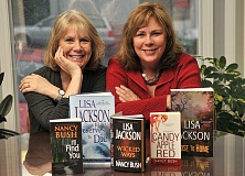 FILE PHOTO: VERN UYETAKE  - Lake Oswego best-selling authors Nancy Bush, left, and her sister, Lisa Jackson, pose with a few of their books in 2014. The authors have more than 150 titles to their credit. Jacksons newest book Expecting to Die will be released Feb. 28.