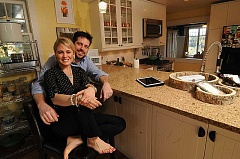 STAFF PHOTO: VERN UYETAKE - At home in Dunthorpe, Pamela and Marc Zemp enjoy hanging out in the kitchen, where Marc can be found making pizzas.  Before: The Zemps took their kitchen down to the studs as they renovated their 1912 home.