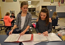 5. Ella Kuntz, left, and Allison Buturla go over their lines together at their rehearsal at Cedaroak Primary.