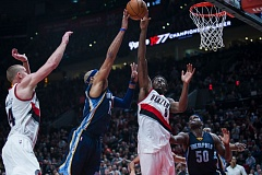 TRIBUNE PHOTO: JOHN LARIVIERE - Al-Farouq Aminu of the Trail Blazers blocks a shot by Memphis' Vince Carter in the closing seconds of Friday's game at Moda Center.