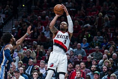 TRIBUNE PHOTO: JOHN LARIVIERE - Portland guard Damian Lillard has all the space he needs to shoot in a 33-point outing and victory against the Memphis Grizzlies.